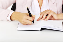 Closeup photo of female hand writing notes Royalty Free Stock Photography