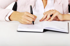 Closeup photo of female hand writing notes Royalty Free Stock Images