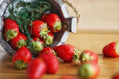 Red strawberry on wooden background Royalty Free Stock Images