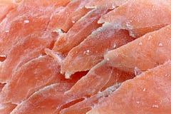 Closeup photo of frozen sliced raw salmon Stock Image