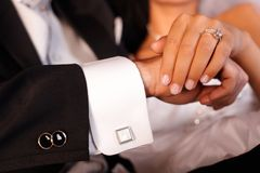 Closeup photo of hands on wedding-day. Closeup photo of bride and groom hands with engagement ring royalty free stock photos
