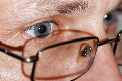 Closeup photo of human eyes with glasses Stock Photo