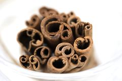 Closeup photo image of cinnamon/cannella stick isolated on white stock photography