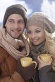 Closeup photo of loving couple at wintertime Stock Photos