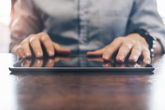 Closeup photo male hands touching screen tablet. Concept of using electronic devices. HR manager working on modern device stock images