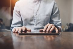 Closeup photo of male hands touching screen tablet. Modern table royalty free stock photos