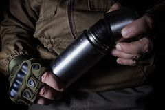 Man in gloves holding vacuum thermos bottle stock images
