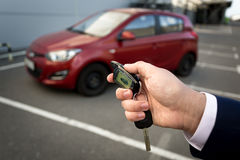 Closeup photo of man opening car with remote alarm key Stock Photography