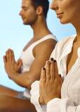 Closeup photo of meditating people. Women with extravagant nail polish Royalty Free Stock Photo