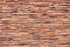 Brown brick wall. Closeup photo of modern brown brick wall background Royalty Free Stock Photo