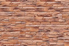 Brown brick wall. Closeup photo of modern brown brick wall background Stock Photos