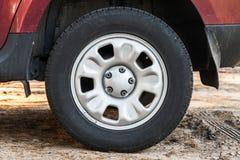 Closeup photo of modern steel car wheel Royalty Free Stock Photo