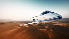 Closeup Photo Modern White Luxury Generic Design Airplane.Private Jet Cruising High Altitude, Flying Over Desert.Empty. Blue Sky with Sun Background. Business Royalty Free Stock Photography