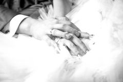Closeup photo of newly married couple holding hands. Black and white closeup photo of newly married couple holding hands Royalty Free Stock Photos