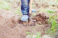 Free Closeup Photo Of Man Digging Soil At Garden Stock Image - 58176751