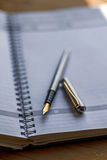 Closeup photo of open notebook with a fountain pen Stock Images