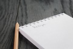 Closeup photo of open notepad with word recipe Royalty Free Stock Photos