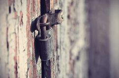 Closeup photo of a padlock on door Royalty Free Stock Images