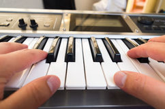 Closeup photo of a person's hands playing piano Royalty Free Stock Photo