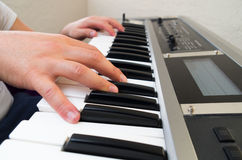 Closeup photo of a person's hands playing piano Royalty Free Stock Image