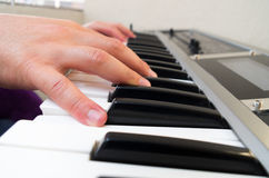 Closeup photo of a person's hands playing piano Stock Image