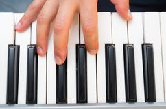 Closeup photo of a person's hands playing piano Stock Photos