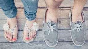Closeup Photo of Person Wearing Gray Boat Shoes and Gray Flip-flops Royalty Free Stock Image