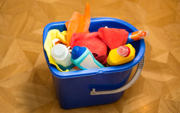 Closeup photo of plastic bucket with cleaning equipment Stock Image