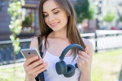 Closeup photo portrait of beautiful dreamy positive nice pretty cute lovely she her lady using tech gadget choosing track from. Playlist internet calling royalty free stock image