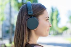 Closeup photo portrait of cheerful peaceful calm tranquil serene satisfied glad positive nice she her lady using modern gray. Headset enjoying dj mix song sound stock photos