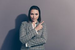 Closeup photo portrait of confident serious charming thoughtful office lady making choice pointing with forefinger stock images