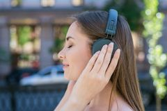 Closeup photo portrait of satisfied cheerful cute dreamy pretty with long straight hairstyle she her cool lady touching modern. Headset enjoying careless life royalty free stock images