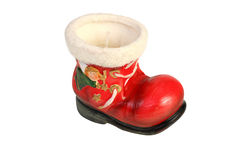 Closeup photo of a red boot-shaped christmas candle Royalty Free Stock Image