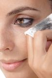 Closeup photo of removing eye makeup Royalty Free Stock Photo