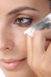 Closeup photo of removing eye makeup royalty free stock photo
