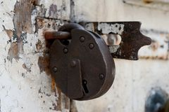 Old rusty padlock on a weathered door royalty free stock photos