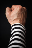 Closeup photo of sailor fist  on dark background Royalty Free Stock Photo