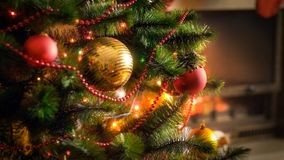 Closeup image of shiny baubles and glowing colorful light garlands on Christmas tree. Closeup photo of shiny baubles and glowing colorful light garlands on royalty free stock photography