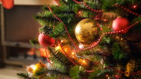 Closeup image of shiny and glowing decorations on Christmas tree at house. Closeup photo of shiny and glowing decorations on Christmas tree at house royalty free stock image