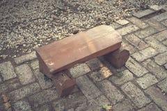 Closeup photo of a small wooden bench. Outdoor photo Stock Photos