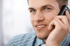 Closeup photo of smiling businessman on mobile Royalty Free Stock Images