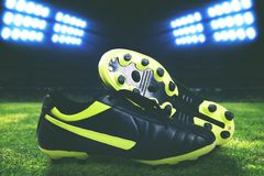 Closeup photo of a soccer boot. In a stadium stock images