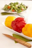 Closeup photo of sweet peppers on a plate Royalty Free Stock Photos