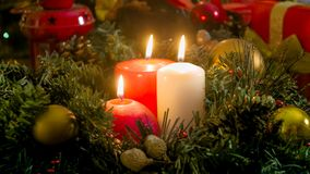 Closeup image of three burning candles on Christmas eve Stock Images