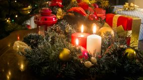 CLoseup image of three burning candles on wooden table decorated for Christmas celebration Stock Image