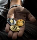 Closeup Photo of Three Round Coins in Person's Palm stock images