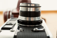 Closeup photo of vintage camera lying on wooden desk royalty free stock photos