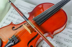 Closeup photo of violin and bow. On note sheet with text space Royalty Free Stock Photo