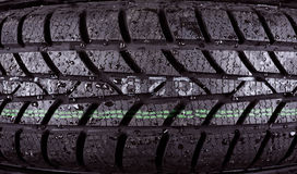 Closeup photo of a wet tire Royalty Free Stock Photos