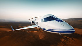 Closeup Photo White Luxury Generic Design Airplane.Private Jet Cruising High Altitude, Flying Over Desert.Empty Blue Sky Royalty Free Stock Photos